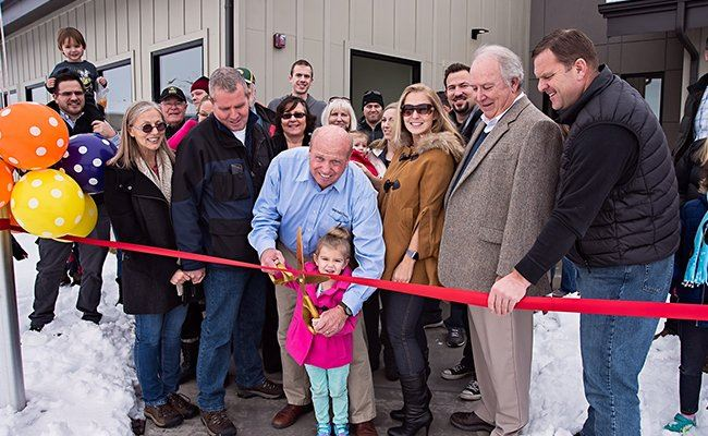 The Town Council of Vineyard cutting a ribbon in celebration.