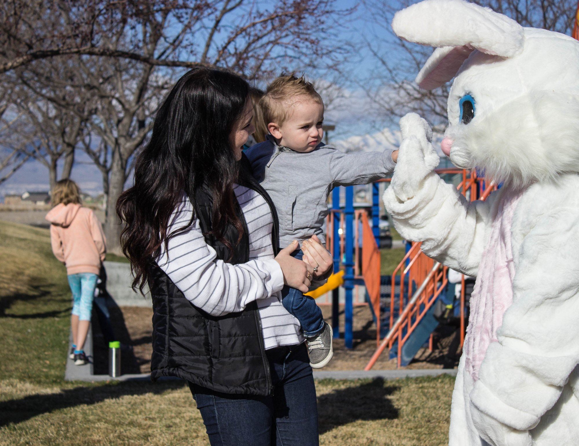 The Easter Bunny with a parent and child.