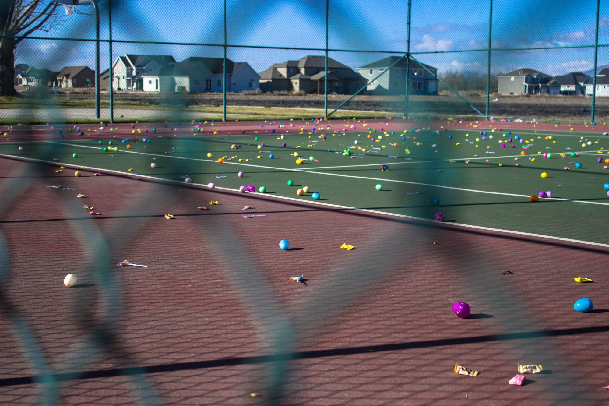 Easter eggs on a tennis court.